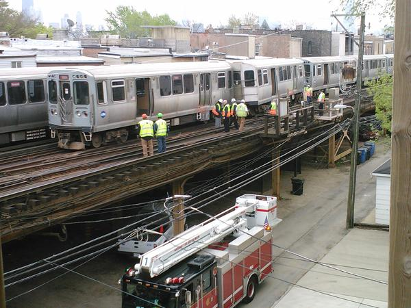 Workers at the scene of a CTA derailment on the Red Line near Armitage Avenue today.