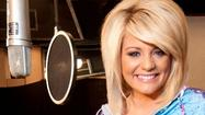 "Former ""American Idol"" contestant and country singer Lauren Alaina has recorded the official theme song for SeaWorld Orlando's upcoming attraction Antarctica: Empire of the Penguin."