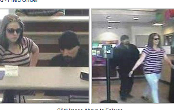 Surveillance photos of a man and woman bank robbers at 1950 W. 33rd St. on Wednesday.