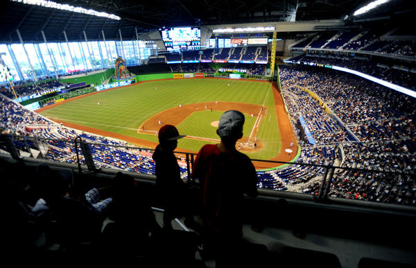 Josh Pimentel (right) and Nicholas Peraza watch the last Marlins game of the season against the New York Mets at Marlins Park. 10/3/12. Jim Rassol, Sun Sentinel.