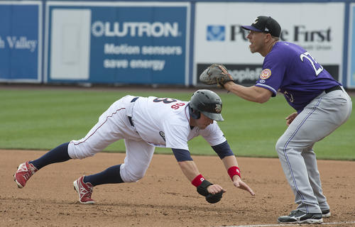 Lehigh Valley IronPigs infielder Josh Fields dives back to first base on a pick off attempt by Louisville Bats pitcher Pedro Villarreal, as first baseman Mike Hessman waits for throw in the bottom of the 4th inning at Coca-Cola Park on Thursday.