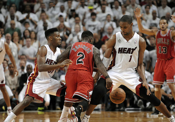 Bulls guard Nate Robinson dribbles the ball between the legs of Miami Heat forward Chris Bosh during the second quarter of Game 2.