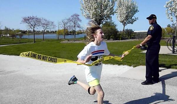 Kayleigh Pitterman, 13, on the left, was the first among 50 students and six Glenview police officers to reach the finishing line in a 1-mile fundraising race at Attea Middle School in Glenview.