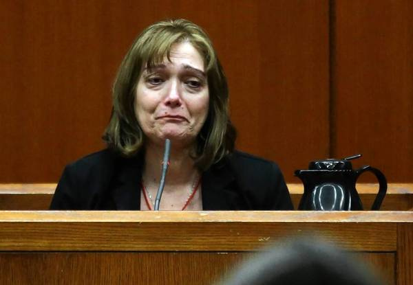 Christina Borizov becomes emotional as she testifies Tuesday at the DuPage County Courthouse in Wheaton during the trial of her son, Johnny Borizov, who is charged with murder and solicitation of murder.