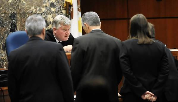 Judge Daniel Guerin talks with attorneys in a sidebar conference as testimony continues in the murder and murder solicitation charges against Johnny Borizov at the DuPage County Courthouse.