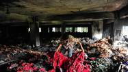 NEW DELHI — A deadly fire at a garment factory in Bangladesh raised new cries for improvements in the country's industrial safety conditions Thursday, two weeks after a massive building collapse killed at least 950 people.