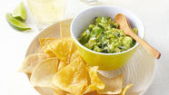 This delicious guacamole recipe replaces half the amount of high-calorie avocado in a traditional guacamole recipe with a stealth low-calorie vegetable -- zucchini -- to cut 100 calories and 6 grams of fat so we can eat more guacamole with fewer calories. We use the microwave to cook the zucchini until it's very tender, but you can steam it on the stovetop if you prefer.