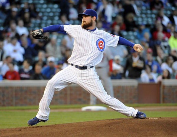 Cubs starting pitcher Travis Wood pitches against the Cardinals during the first inning at Wrigley Field.