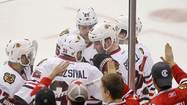 Chicago Blackhawks players celebrate Bryan Bickell's third period goal against Minnesota Wild' in Game 4 of an NHL Western Conference quarter-finals hockey playoff series in St. Paul,
