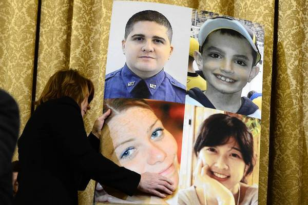 Photos of the bombing victims and the officer shot to death at MIT are on display at a congressional hearing, during which local police complained that federal officials hadn't told them more about the suspects.