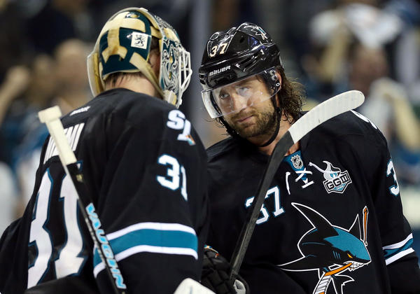 Adam Burish with Sharks goalie Antti Niemi after defeating the Canucks in game 3.