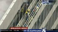 Los Angeles firefighters Thursday evening were rescuing workers trapped in scaffolding on the side of a 27-story building in Century City.