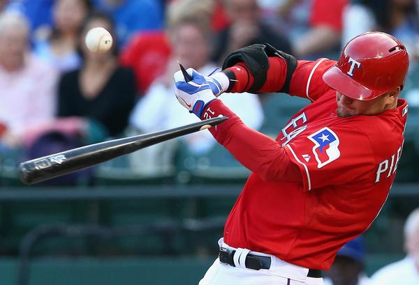 The Rangers' A.J. Pierzynski breaks his bat against the Red Sox.
