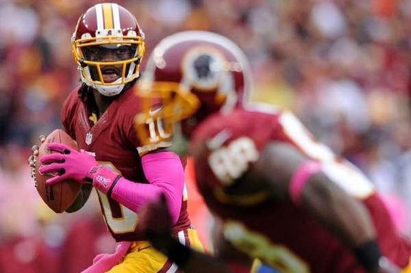 Will DirecTV pass on Sunday Ticket? Above, Redskins quarterback Robert Griffin III.