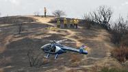 Photo Gallery: Glendale Police helicopter assists Gendale Fire Department gather hose left in hills after brush fire