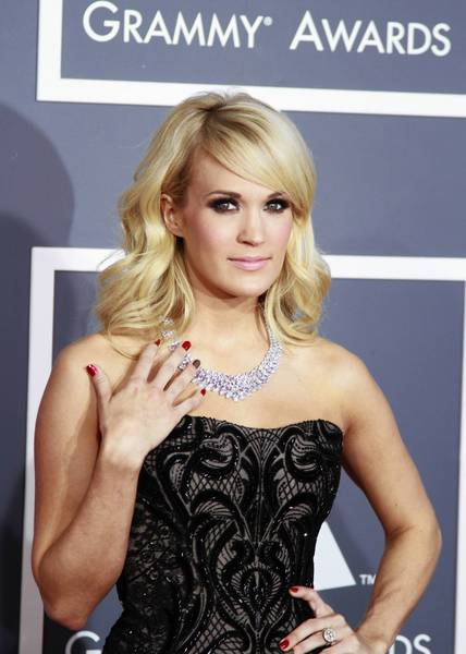 "Carrie Underwood will replace Faith Hill as the ""Waiting All Day For Sunday Night"" singer leading into NBC's Sunday night NFL game this season."