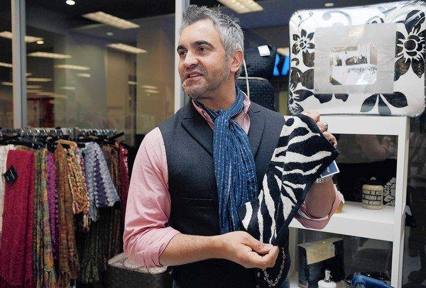 Interior designer Martyn Lawrence Bullard's product lines include fabrics, wallpapers and furniture. Above, he checks out a print at a Marshalls store in Los Angeles.