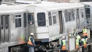 A Red Line train car derailed near Armitage Avenue on Thursday, halting trains and sending at least one person to the hospital.