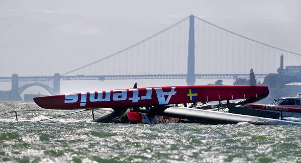 "The Artemis Racing AC72 catamaran, an America's Cup entry from Sweden, lies capsized in San Francisco Bay on Thursday. Andrew ""Bart"" Simpson, an Olympic gold medalist from Great Britain, died after the capsized boat's platform trapped him underwater for about 15 minutes."