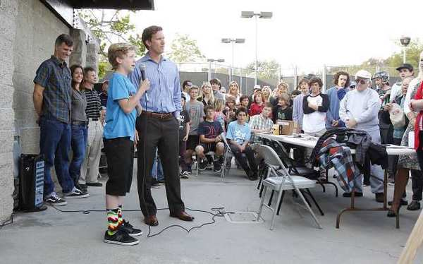 Residents and neighbors of Arch Beach Heights listen as young local skater Sam Dameshek makes his case for why he and his fellow skaters in Laguna need a skatepark during a community meeting at Moulton Meadows Park, Thursday.