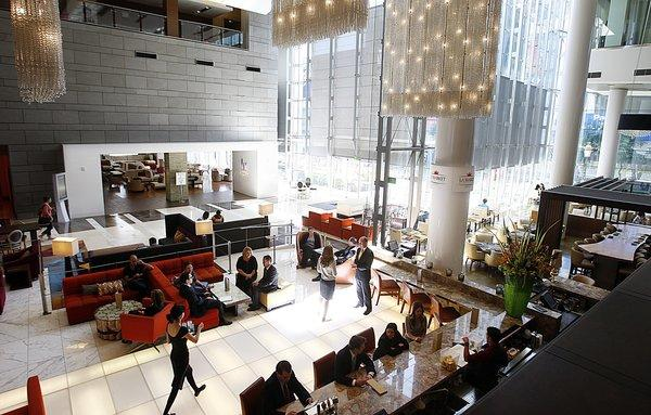 The JW Marriott Los Angeles LA Live and the Ritz-Carlton Los Angeles share a building near Staples Center. Both brands are favorites among affluent travelers, a survey finds.