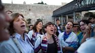 JERUSALEM -- Thousands of ultra-Orthodox Jews flooded into the Old City's Western Wall Plaza early Friday in a boisterous and sometimes violent protest against a group of female activists exercising a newly court-affirmed right to pray at the holy site in a similar fashion as men do.
