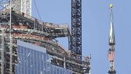 NEW YORK (AP) - The silver spire topping One World Trade Center has been fully installed on the building's roof. That brings the iconic structure to its full, symbolic height of 1,776 feet.