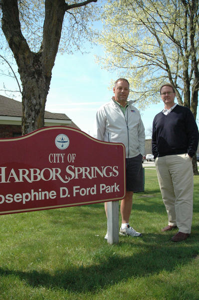 Harbor Springs Area Chamber of Commerce president Tom Trautman (left) and executive director Daniel DeWindt stand near the building they hope the chamber will occupy at the waterfront in Harbor Springs.