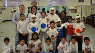 Gear for Goals' Executive Director Dr. Warren Bruhl poses with Working Together Tae Kwon Do Class