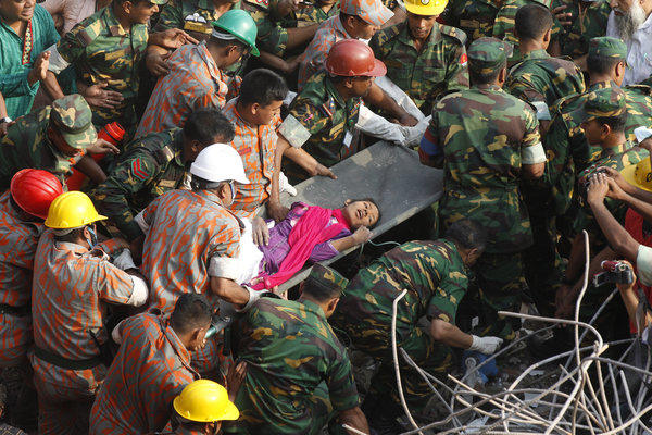 Bangladeshi rescuers retrieve garment worker Reshma from the rubble of a building in Savar on Friday,, 17 days after the eight-story building collapsed.