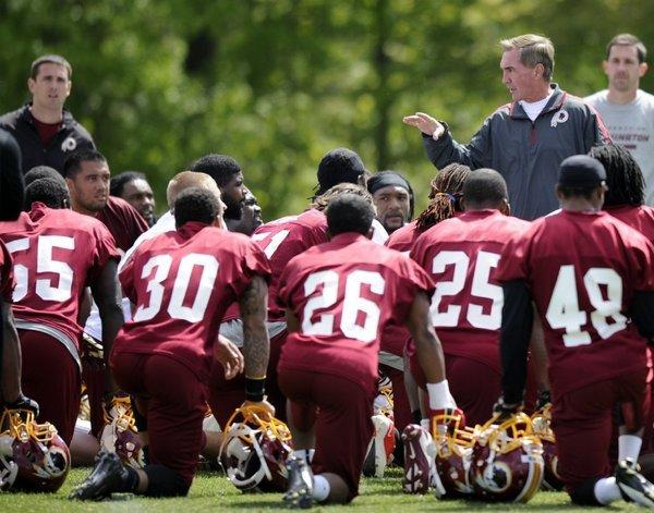 Washington Redskins Coach Mike Shanahan talks to players at rookie camp on May 5.