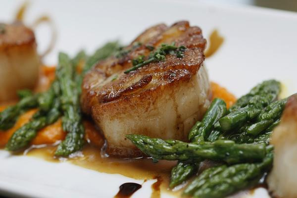 Scallops with heirloom carrot puree, asparagus, and aged balsamic vinegar.