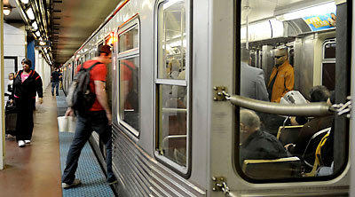 A rider boards a CTA train