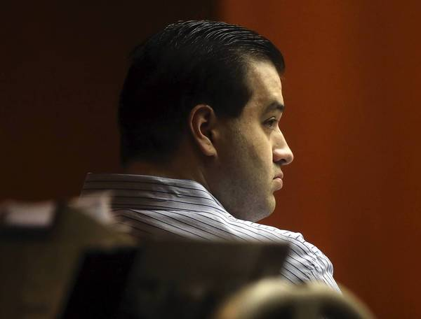 Johnny Borizov is pictured during his trial in a DuPage County courtroom on Friday. Prosecutors contend that Borizov, who is charged with murder, conspiracy and solicitation, pressured Jacob Nodarse to shoot and kill Michael Kramer, 20, and Kramer's parents, Jeffrey, 50, and Lori, 48.