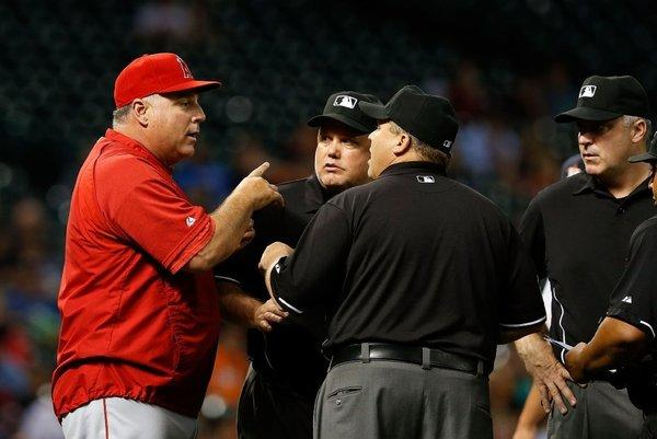 Angels Manager Mike Scioscia argues a call with the umpire in the seventh inning of a game against the Houston Astros on May 9.