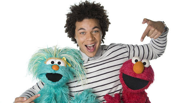 "Ismael Cruz Cordova, center, joins the cast of ""Sesame Street."""