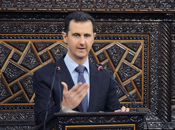 Syrian President Bashar Assad delivers a speech at parliament in Damascus in June.