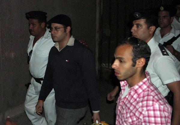 Egyptian youth activist Ahmed Maher, second from left, is accompanied by police after he was arrested at Cairo's international airport.