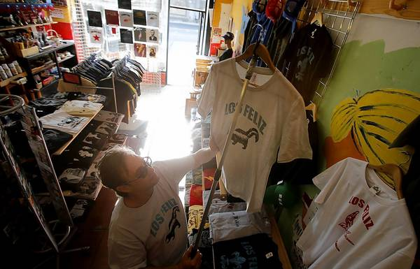 "However you pronounce it, Bill Wyatt hopes folks will buy his ""Los Feliz"" T-shirts at his store."