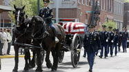 "<span style=""font-size: small;"">BREMEN — Hundreds gathered along the streets of downtown Bremen today to bid farewell to their beloved ""Doc.""</span>"