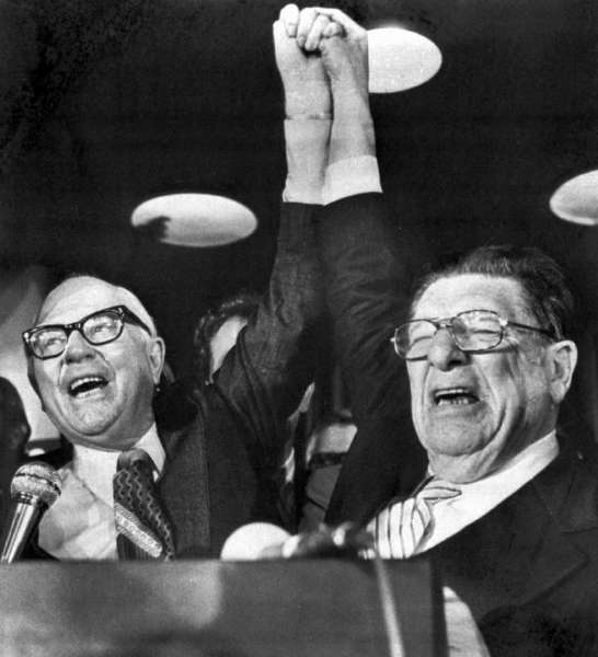 Paul Gann, left, and Howard Jarvis hold up their hands on the night of June 7, 1978, after it appeared Proposition 13 would pass.