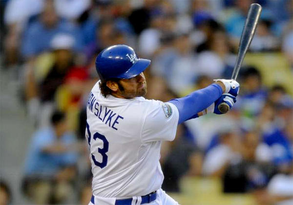 Dodgers outfielder Scott Van Slyke hits a three-run home run during a game against the St. Louis Cardinals last season.