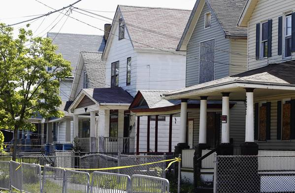 Yellow crime scene tape surrounds the Cleveland house where authorities say Ariel Castro held three women captive for a decade.