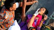 NEW DELHI — In a development described as miraculous, a woman trapped in rubble for 17 days emerged alive Friday from the remains of a building that pancaked just outside Dhaka, the capital of Bangladesh.
