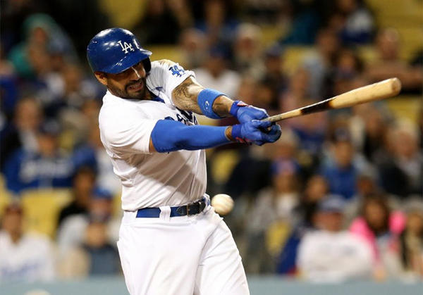 Dodgers' Matt Kemp swings and misses during a game against the Arizona Diamondbacks at Dodger Stadium.