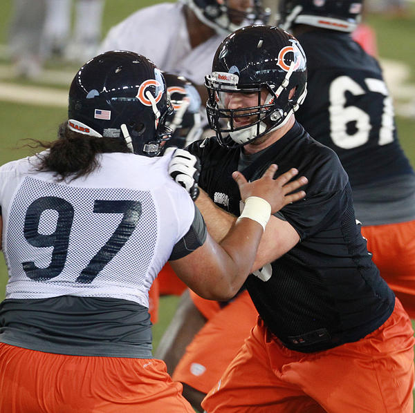 Offensive guard Kyle Long (right) works on the block of Christian Tupou.