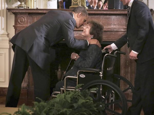 President Obama greets Natoma Canfield, a cancer survivor from Ohio, at a Mother's Day event at the White House. Obama used the occasion to speak about the benefits of his healthcare law.