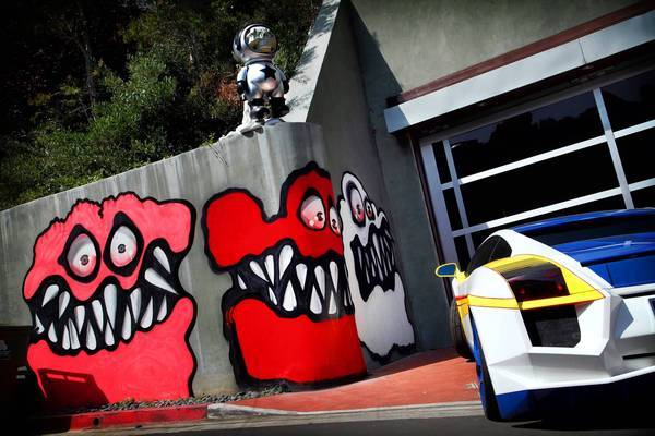 Colorful, and toothy, faces adorn a retaining wall at entertainer Chris Brown's Hollywood Hills house. Residents have complained, but his lawyer, Mark Geragos, says it's a 1st Amendment issue.