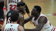 Heat forward LeBron James is shoved by Bulls center Nazr Mohammed during Friday's second-quarter altercation at the United Center. (Scott Strazzante, Chicago Tribune)