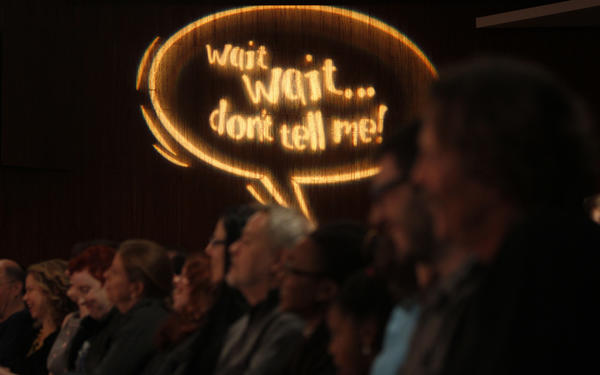 "Signage on the wall during a live taping of ""Wait, Wait Don't Tell Me"" at the Chase Auditorium, December 3, 2011."